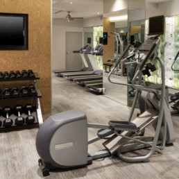 fitness center with various cardio machines, flat screen tv and free weights - courthouse va luxury apartments