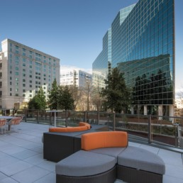 Courtyard with social seating with trees and buildings in the background - luxury arlington va apartments