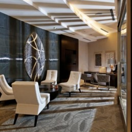 leasing center with desk, social seating, flat screen tv, modern artwork and view of the lobby - luxury apartments in alrlington va