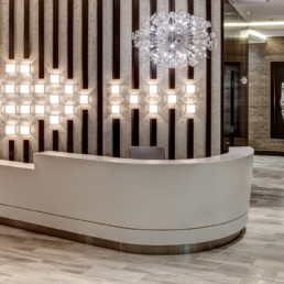 concierge desk with modern artwork and lighting - courthouse va luxury apartments