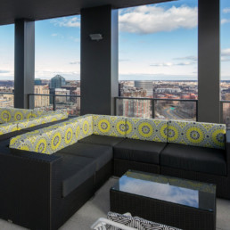 outdoor terrace with couch and view of the city - luxury apartments in arlington va