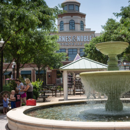 exterior of barnes and noble bookstore and large park fountain near tellus luxury apartments in courthouse va