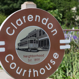 clarendon court house neighborhood sign with flowerbeds in the background - luxury apartments in arlington va