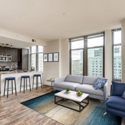 tellus living area with view of kitchen at a luxury arlington apartment building